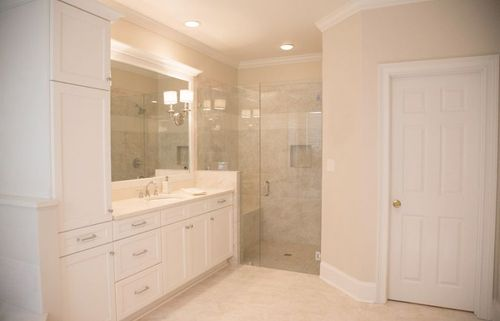 Master bathroom shower and tile floor