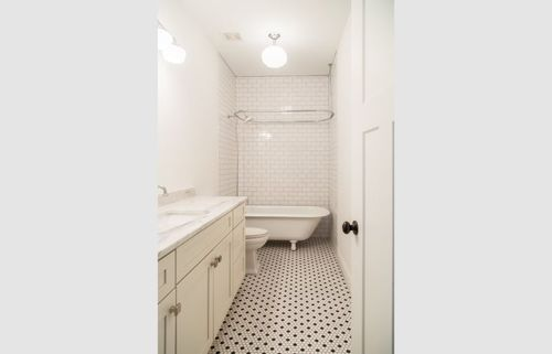 Master bathroom white cabinets and tile floor remodel