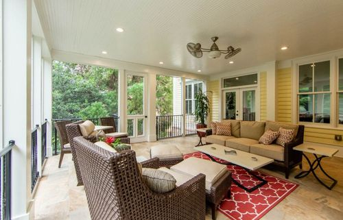 Hi-end screened porch with a big entertaining area.