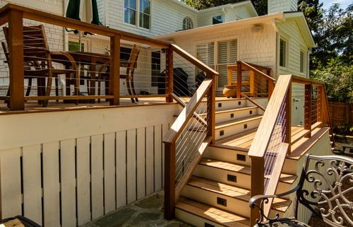 Back deck featuring outdoor accent lighting on the stairs.