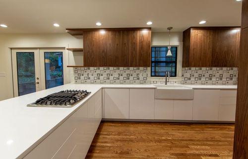 Kitchen remodel geometric tile backsplash.