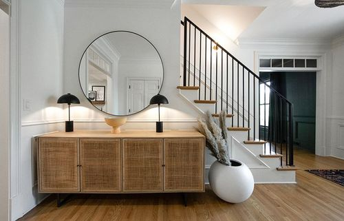 A new black iron railing gives this entryway a modern minimal look.