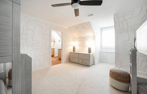 Unique yet subtle artistic wallpaper covers this bedroom.
