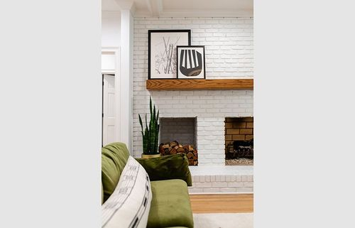 What's not to love with a painted white fireplace and  wood mantel combo?