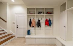 Finished basement with custom built-ins for mudroom.