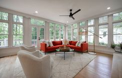A gallery of windows allows natural light to flow around these gorgeous hardwood floors.